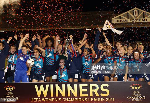 Olympique Lyonnais' celebrate after winning the UEFA Women's Champions League final football match against FFC Turbine Potsdam at Craven Cottage in...