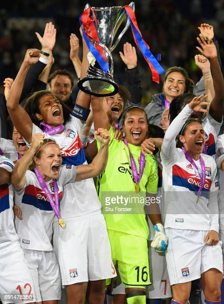 Olympique Lyonnais celebrate with the trophy after the UEFA Women's Champions League Final between Lyon and Paris Saint Germain at Cardiff City...