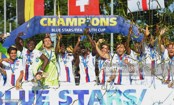 Olympique Lyonnais celebrate with the trophy following their 10 victory during the Final match between Olympique Lyon vs RSC Anderlecht on day two of...