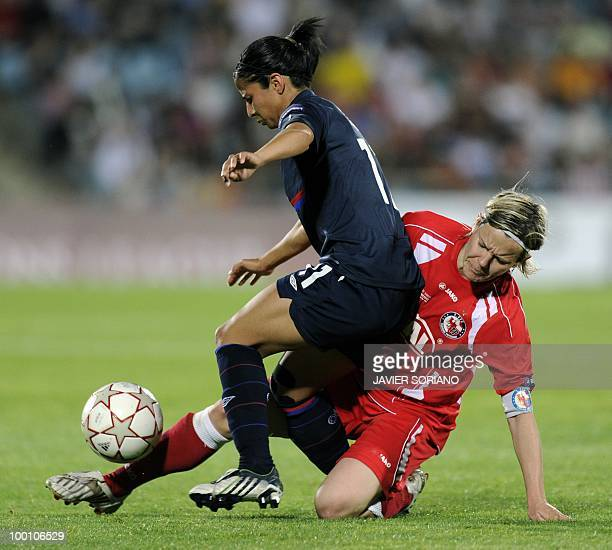 Olympique Lyonnais' Costa Rican midfielder Shirley Cruz Trana vies with FFC Turbine Potsdam's midfielder Jennifer Zietz during their UEFA women's...
