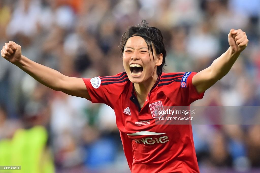 Olympique Lyonnais' defender from Japan Saki Kumagai celebrates after scoring the winning penalty at the end of the UEFA Women's Champions League Final football match VFL Wolfsburg vs Lyon at the Citta del Tricolore stadium in Reggio Emilia on May 26, 2016. Lyon won the final in the penalty shoot-out (4-3; 1-1) / AFP / GIUSEPPE