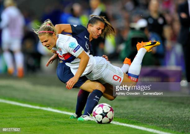 Olympique Lyonnais' Eugenie Le Sommer is fouled by Paris SaintGermain's Eve Perisset during the UEFA Women's Champions League Final match between...