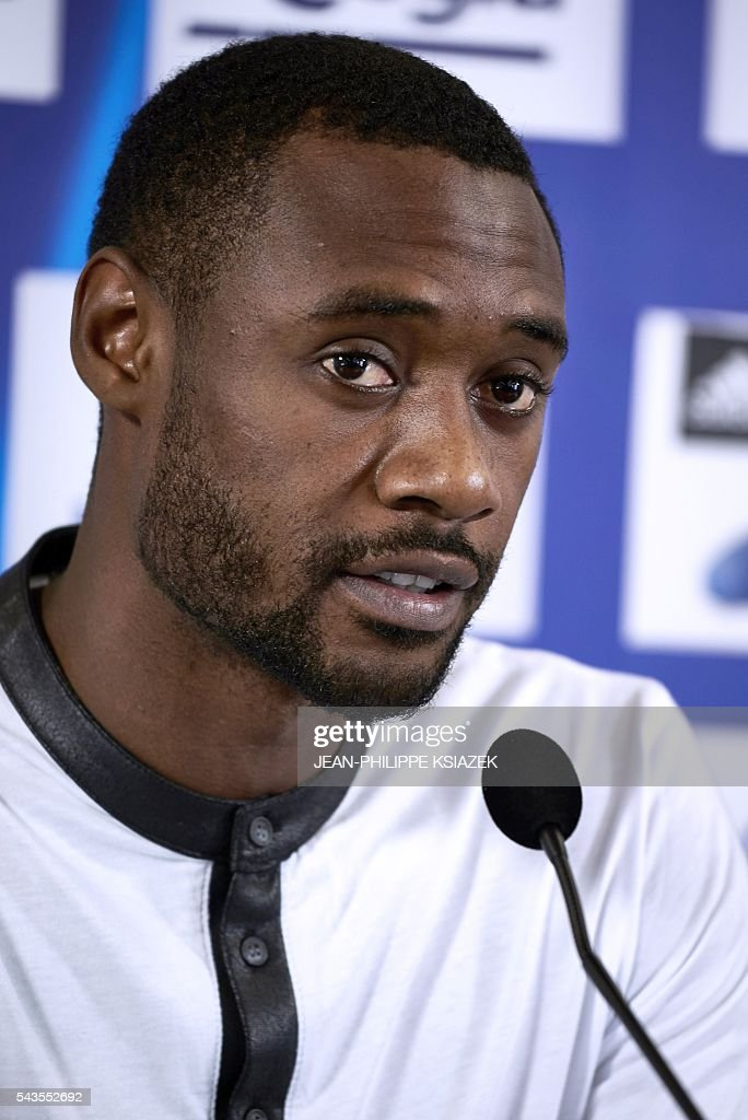 Olympique Lyonnais' football club new player cameroonian Nicolas Nkoulou answers journalists during his official presentation in Lyon on June 29, 2016. / AFP / JEAN