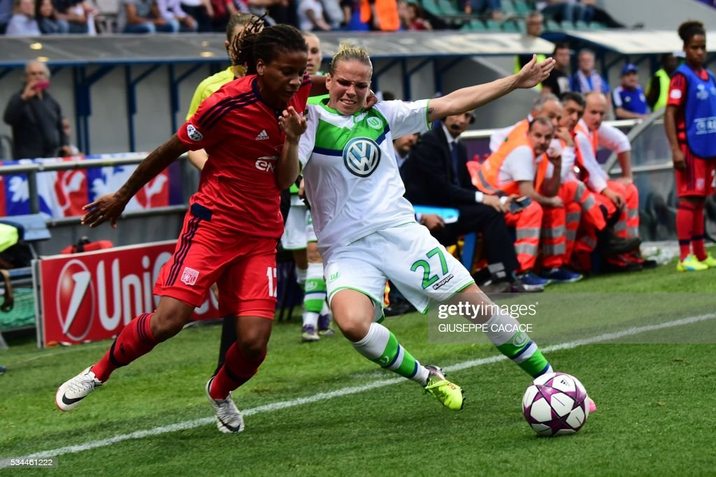 Olympique Lyonnais' forward from France Elodie Thomais (L) fights for the ball with Wolfsburg's midfielder from Germany Isabel Kerschowski during the UEFA Women's Champions League Final football match VFL Wolfsburg vs Lyon at the Citta del Tricolore stadium in Reggio Emilia on May 26, 2016. / AFP / GIUSEPPE