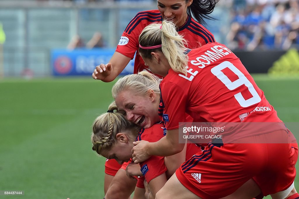 Olympique Lyonnais' forward from Norway Ada Hegerberg (L) celebrates with teammates after scoring during the UEFA Women's Champions League Final football match VFL Wolfsburg vs Lyon at the Citta del Tricolore stadium in Reggio Emilia on May 26, 2016. / AFP / GIUSEPPE