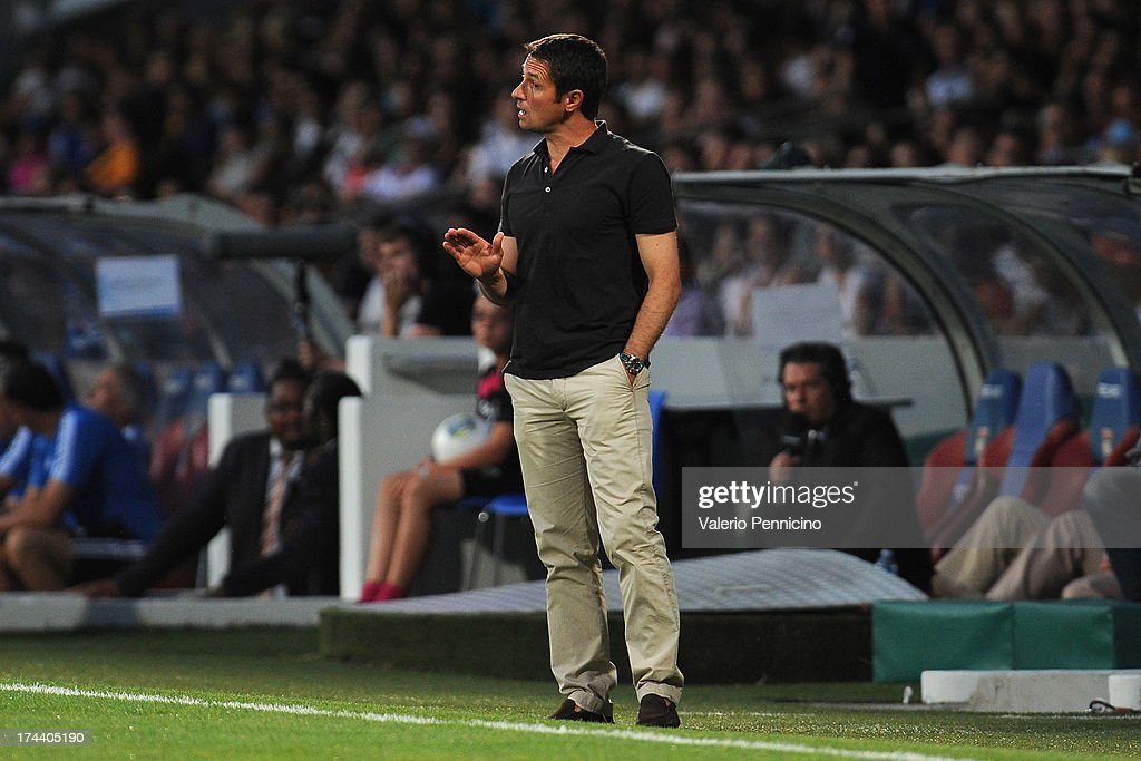 Olympique Lyonnais head coach Remi Garde issues instructions during the Pre Season match between Olympique Lyonnais and Real Madrid at Gerland...