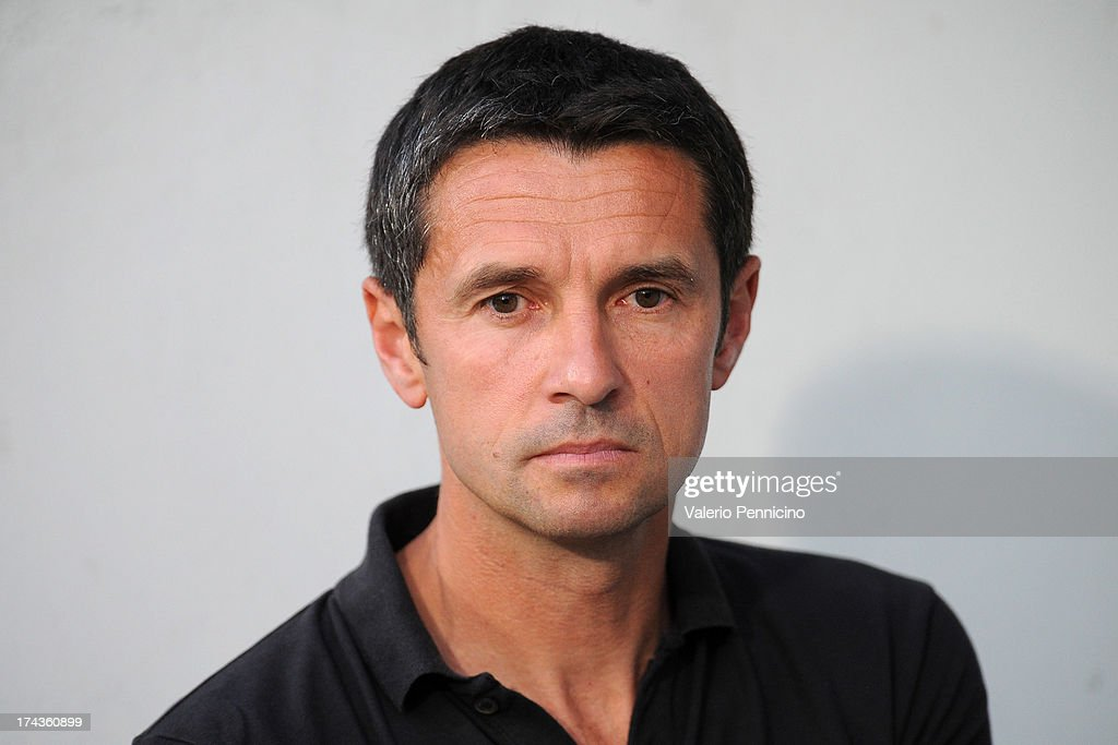 Olympique Lyonnais head coach Remi Garde looks on prior to the Pre Season match between Olympique Lyonnais and Real Madrid at Gerland Stadium on July...