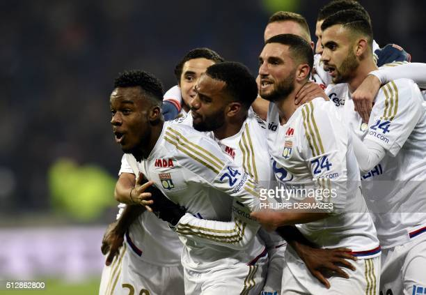Olympique Lyonnais' French forward Maxwell Cornet is congratuled by teamates after scoring during the French Ligue1 football match between Olympique...