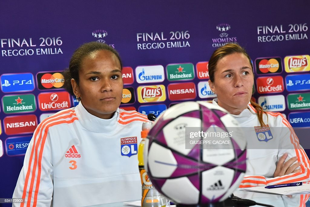 Olympique Lyonnais midfielder Camille Abily (R) and Wendie Renard attend a press conference on the eve of the UEFA Women's Champions League football Final against VFL Wolfsburg at the Stadio Citta del Tricolore in Reggio Emilia on May 25, 2016. / AFP / GIUSEPPE