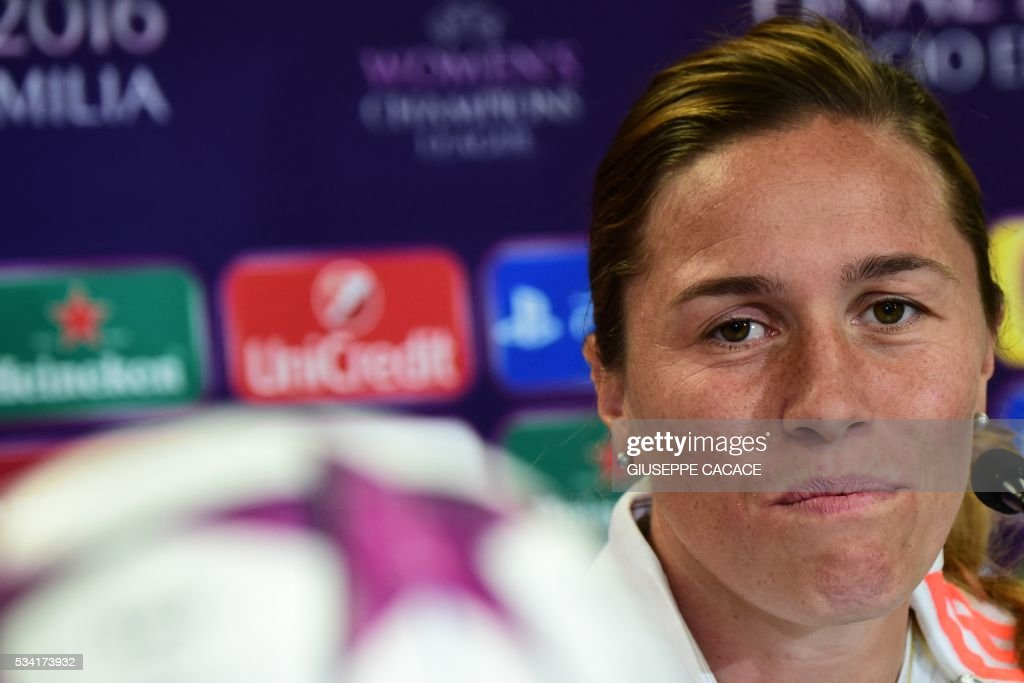 Olympique Lyonnais midfielder Camille Abily attends a press conference on the eve of the UEFA Women's Champions League football Final against VFL Wolfsburg at the Stadio Citta del Tricolore in Reggio Emilia on May 25, 2016. / AFP / GIUSEPPE