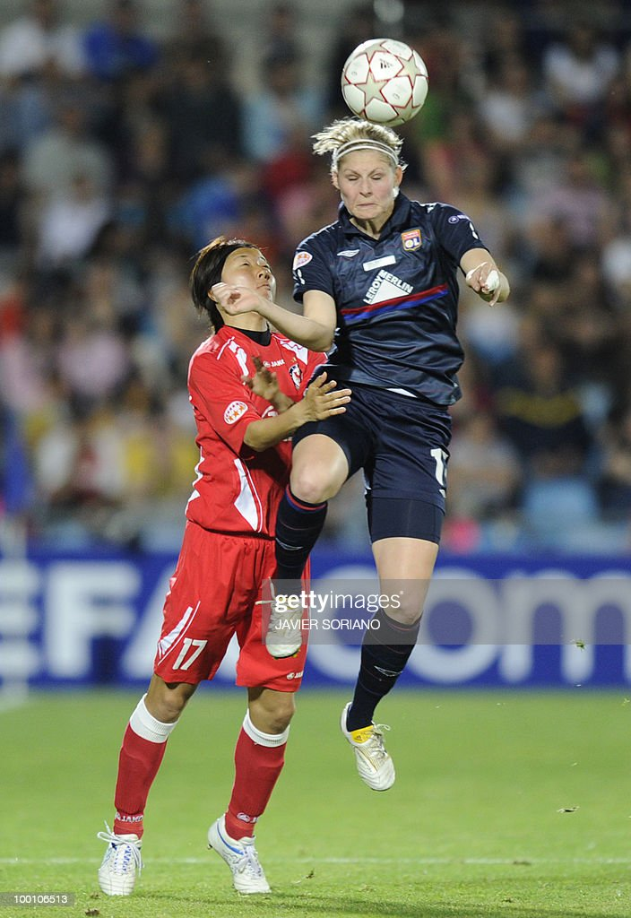 Olympique Lyonnais' midfielder Corine Franco (R) vies with FFC Turbine Potsdam's Japanese forward Yuki Nagasato (L) during their UEFA Women's Champions League final football match beetwen Olympique Lyonnais and FFC Turbine Potsdam at the Coliseum Alfonso Perez stadium in Getafe near Madrid on May 20, 2010.
