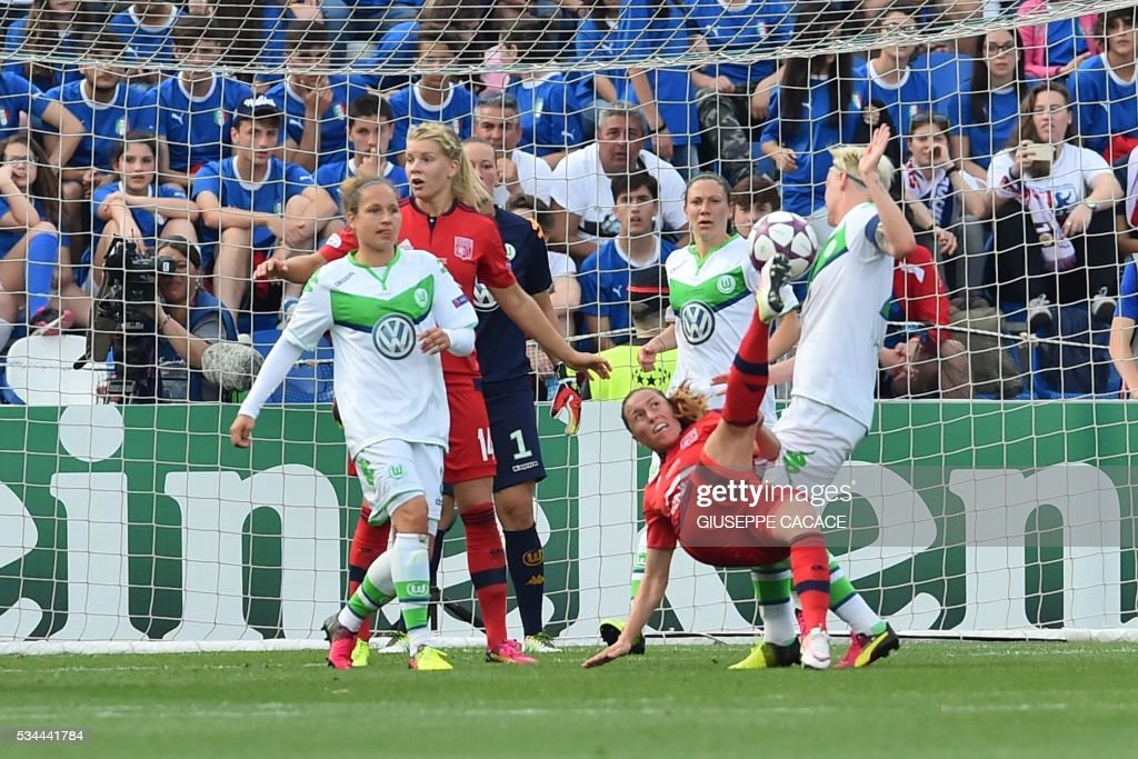 Olympique Lyonnais' midfielder from France Camille Abily (C) kicks the ball during the UEFA Women's Champions League Final football match VFL Wolfsburg vs Lyon at the Citta del Tricolore stadium in Reggio Emilia on May 26, 2016. / AFP / GIUSEPPE