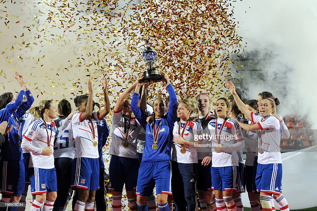 Olympique Lyonnais players celebrate after the International Women's Club Championship Final Match between INAC Kobe Leonessa and Olympique Lyonnais at Nack5 Stadium Omiya on November 25, 2012 in Saitama, Japan.