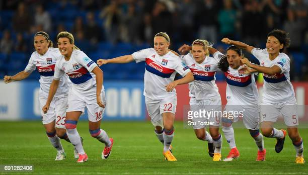Olympique Lyonnais players celebrate in the penalty shoot out during the UEFA Women's Champions League Final between Lyon and Paris Saint Germain at...