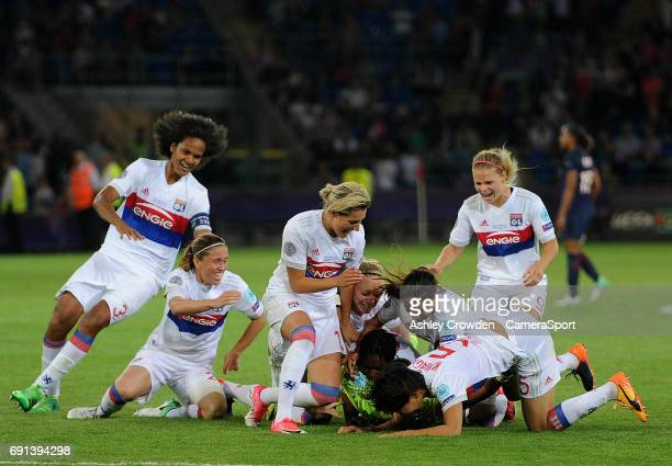 Olympique Lyonnais players celebrate winning the game after Sarah Bouhaddi scores the winning penalty during the UEFA Women's Champions League Final...