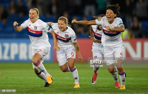 Olympique Lyonnais players Eugenie Le Sommer and team mates celebrate after the UEFA Women's Champions League Final between Lyon and Paris Saint...