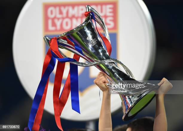 Olympique Lyonnais players hold aloft the trophy after winning the UEFA Women's Champions League Final penalty shoot out between Olympique Lyonnais...