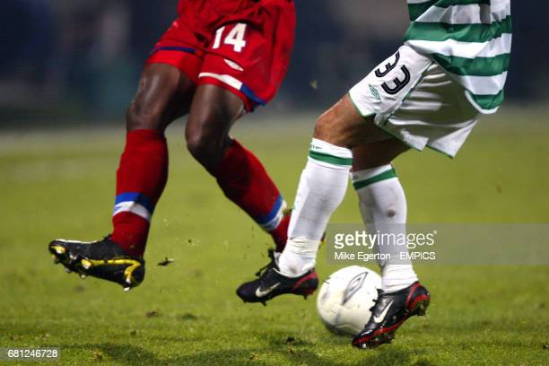 Olympique Lyonnais' Sidney Govou and Celtic's Ross Wallace battle for the ball