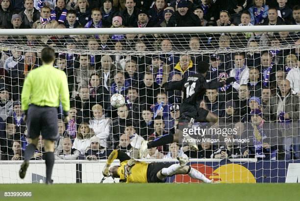 Olympique Lyonnais' Sidney Govou scores the first goal past Rangers' goalkeeper Allan McGregor