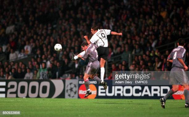 Olympique Lyonnais's Eric Deflandre is beaten to a header by Valencia's Diego Alonso