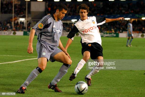 Olympique Marseille's Brahim Hemdani clears the danger from Valencia's Pablo Aimar