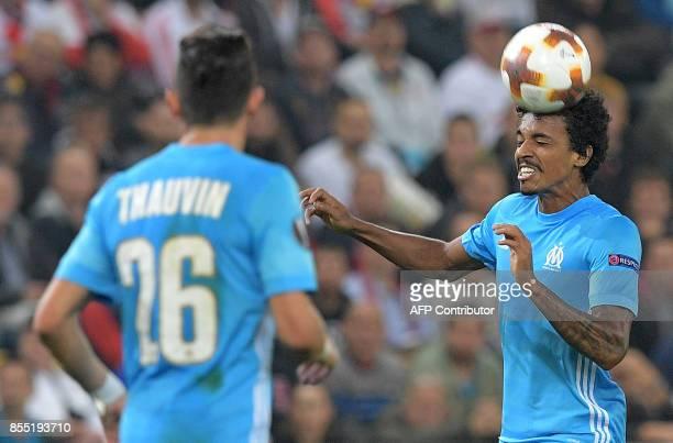 Olympique Marseille's Brazilian midfielder Luiz Gustavo heads the ball during the UEFA Europa League group I football match between FC Salzburg and...