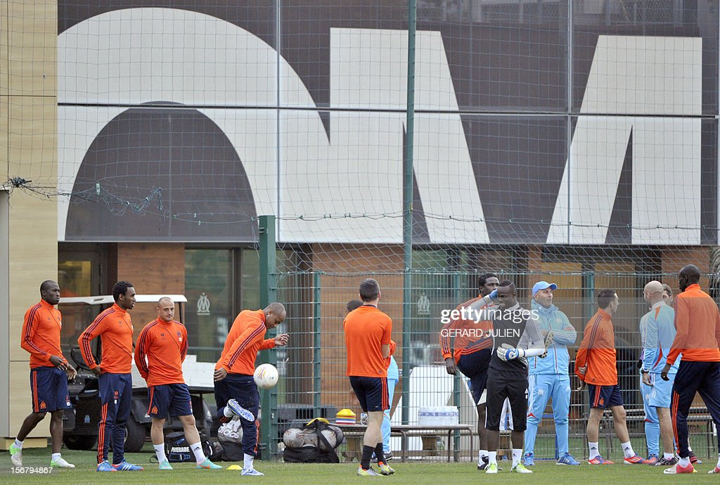 Olympique Marseille's French head coach Elie Baup (R) gives instructions during a training session at the Robert Louis-Dreyfus training camp, on November 21, 2012 in Marseille, on the eve of the UEFA Europa League qualifying football match against Fenerbahçe SK.