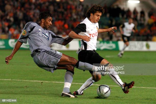 Olympique Marseille's Habib Beye clears the danger from Valencia's Pablo Aimar