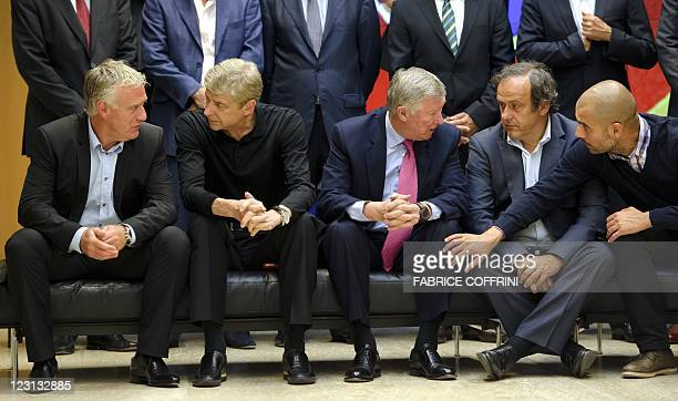 Olympique Marseille's head coach Didier Deschamps Arsenal's manager Arsene Wenger Manchester United's manager Alex Ferguson UEFA president Michel...