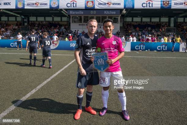 Olympique Marseille's Leo Linnra photo with Kitchee's Ngan CheukPan before their Main Tournament match part of the HKFC Citi Soccer Sevens 2017 on 27...