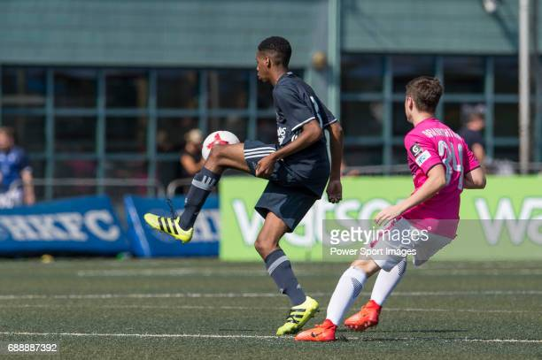 Olympique Marseille's Nassim Ahmed competes with Kitchee's Barak Braunshtain for a ball during their Main Tournament match part of the HKFC Citi...