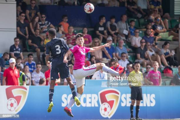 Olympique Marseille's Nassim Ahmed competes with Kitchee's Mark Swainston for a ball during their Main Tournament match part of the HKFC Citi Soccer...