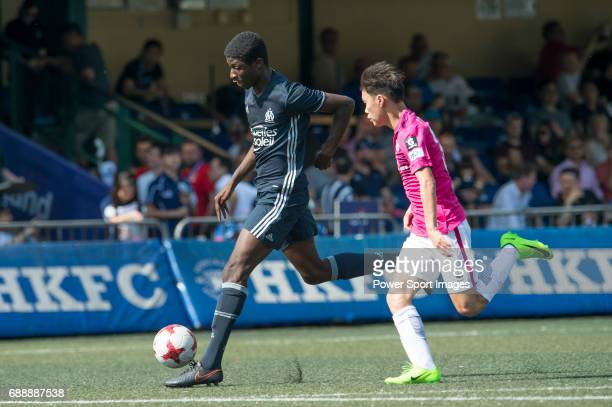 Olympique Marseille's Nassim Ahmed competes with Kitchee's Tsang PakHin for a ball during their Main Tournament match part of the HKFC Citi Soccer...