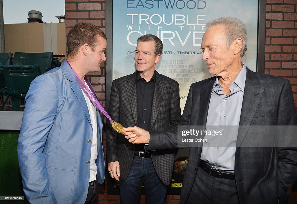 Olypian Ryan Lochte, Director/Producer Robert Lorenz, Actor/Producer Clint Eastwood arrive at the 'Trouble With The Curve' Premiere at Mann's Village Theatre on September 19, 2012 in Westwood, California.