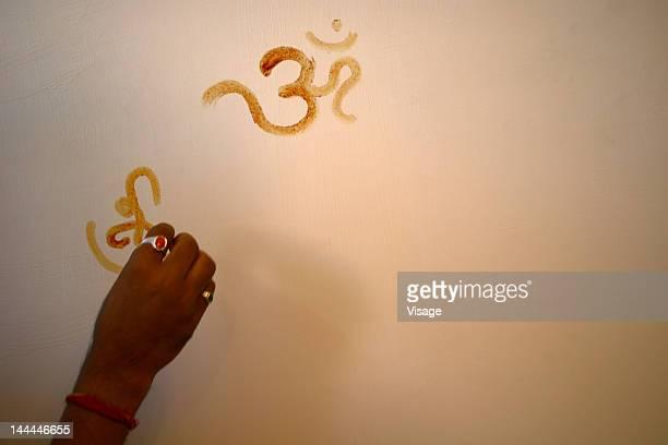 Om being written on a wall