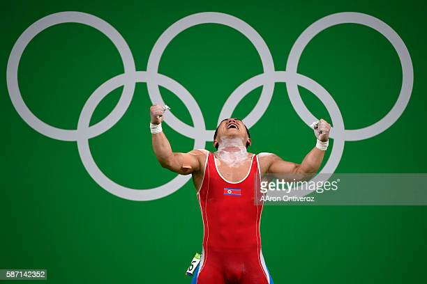 Om YunChol of the People's Republic of Korea reacts after taking the lead and setting an Olympic record on his final lift before losing to China's...