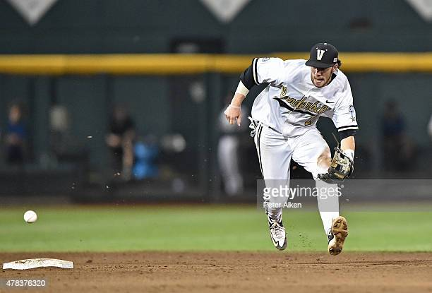 Omaha NE JUNE 24 Shortstop Dansby Swanson of the Vanderbilt Commodores rushes in to field a ground ball against the Virginia Cavaliers in the sixth...