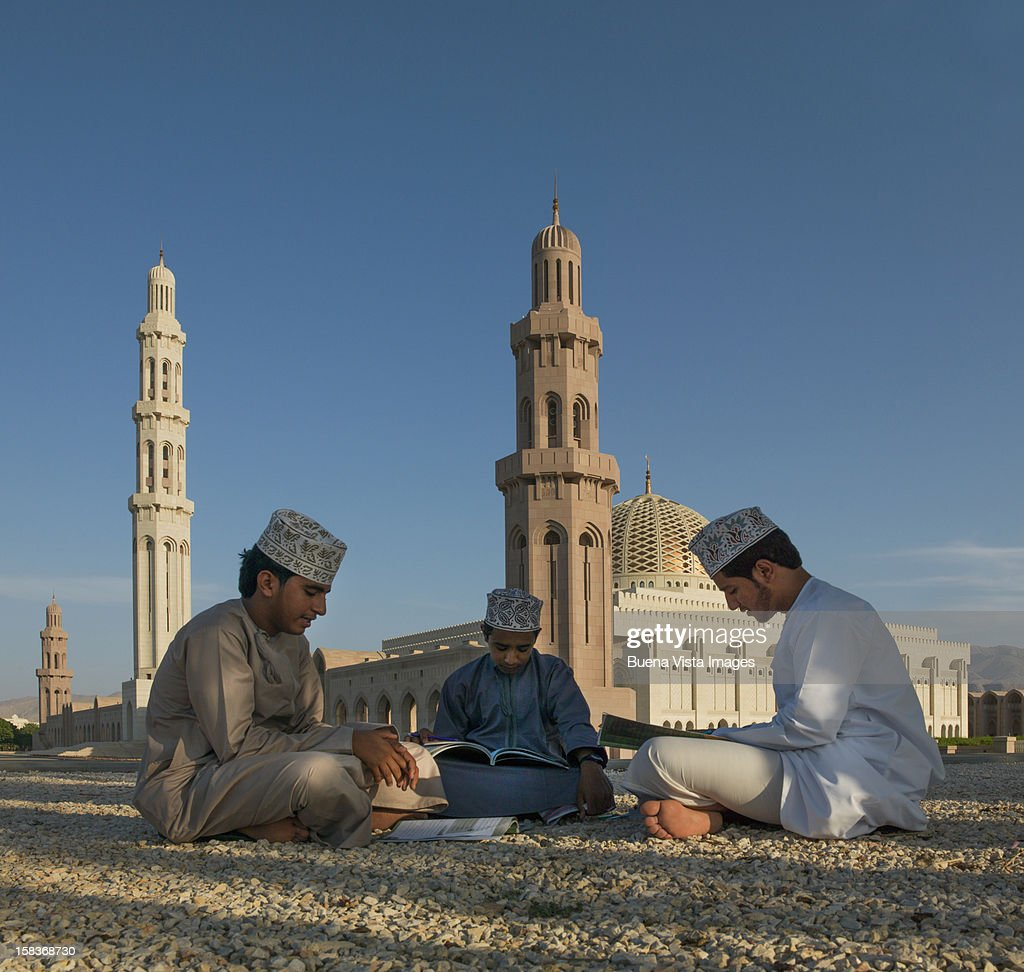 Oman boys studying Koran in a Mosque : Stock Photo