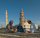 Oman boys studying Koran in a Mosque