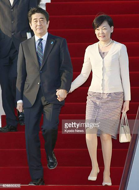 MUSCAT Oman Japanese Prime Minister Shinzo Abe and his wife Akie arrive at Muscat airport in Oman on Jan 9 2014 They are on a weeklong trip to four...
