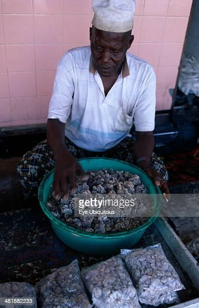 Oman Salalah Trader sorting second grade frankincense