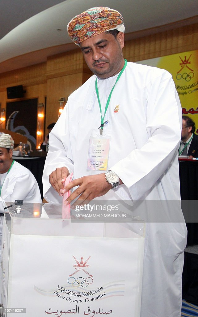Oman Vwillyball Association President, Badar al-Rawas casts his ballot during the election of the Board of Directors of the Oman Olympic Committee (OOC) on April 25, 2013 in the Omani capital Muscat. Omani Khalid bin Mohammed al-Zubair was elected new chairman.