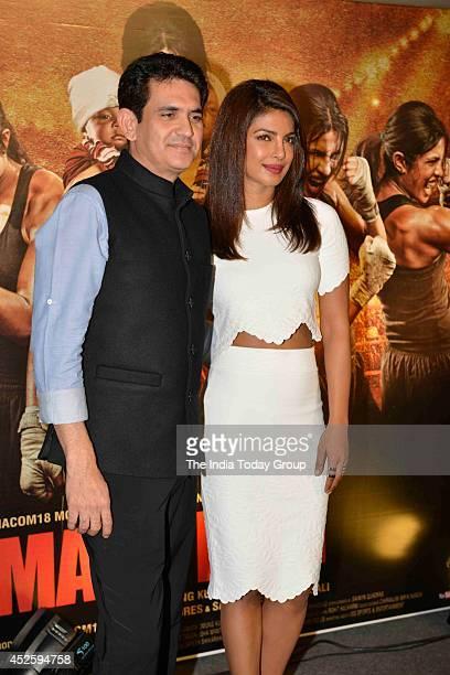 Omang Kumar and Priyanka Chopra at the trailer launch of his upcoming movie Mary Kom in Mumbai