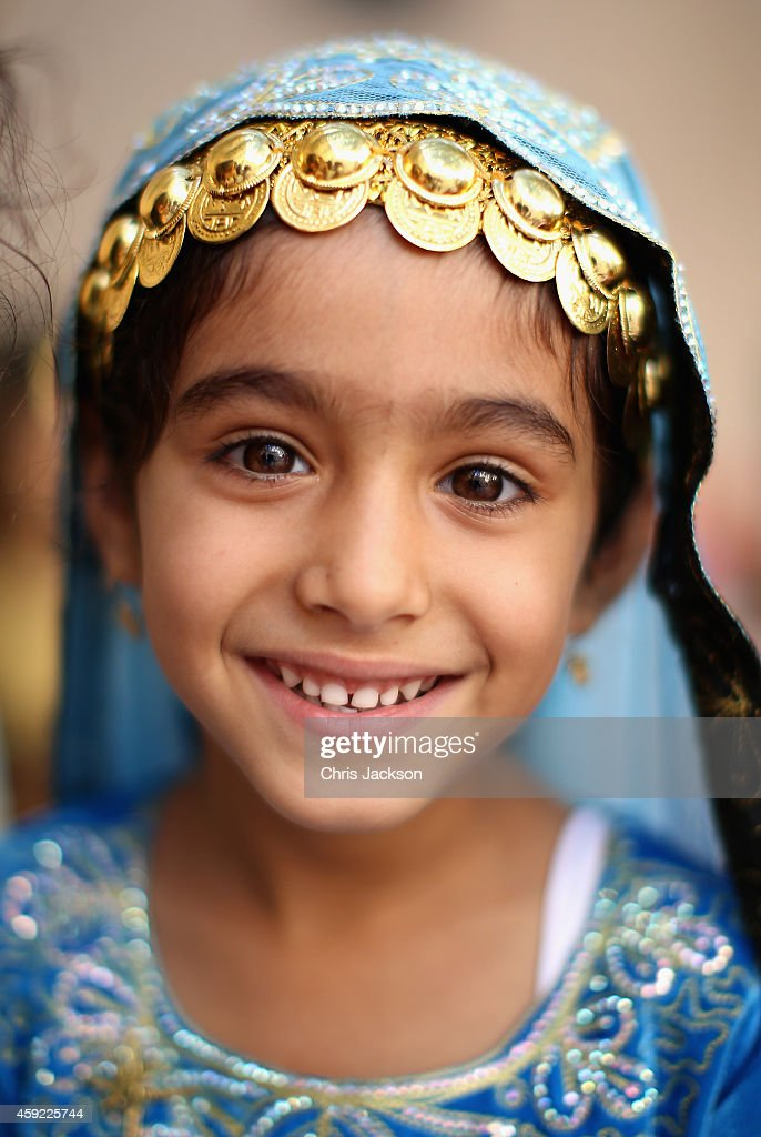Omani children in traditional dress wait for Prince Harry to arrive during a visit to Nizra Fort on November 19 2014 in Muscat Oman Prince Harry is...
