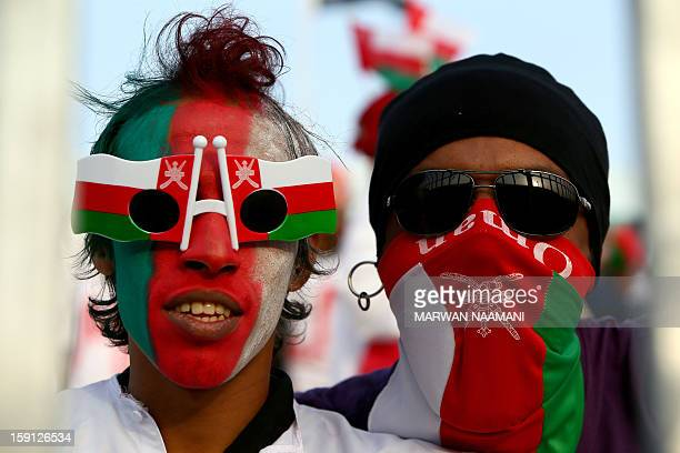Omani fans attend their team's match against Qatar in the 21st Gulf Cup in Manama on January 8 2013 AFP PHOTO/MARWAN NAAMANI