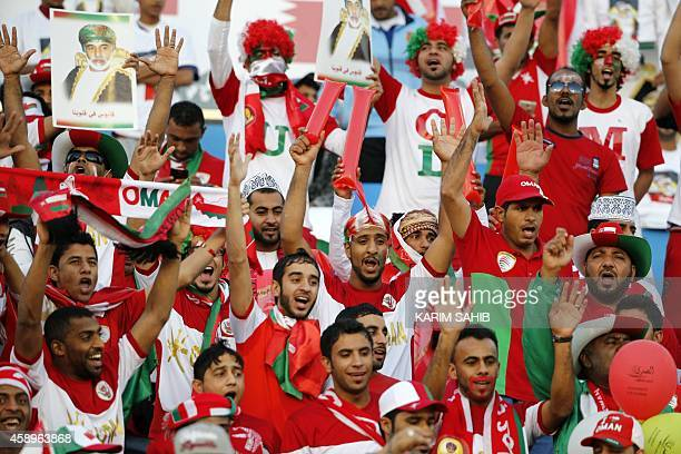 Omani fans cheer for their team prior to the start of the Gulf Cup of Nations Group B football match between United Arab Emirates and Oman on...