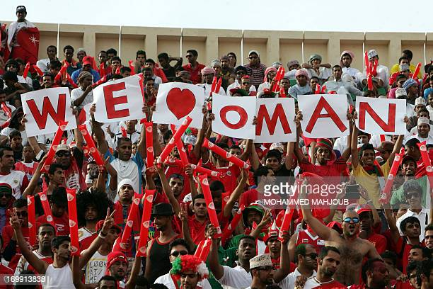 Omani fans support their national team during their group B Asian zone qualifying football match against Iraq on June 04 2013 AFP PHOTO/MOHAMMED...