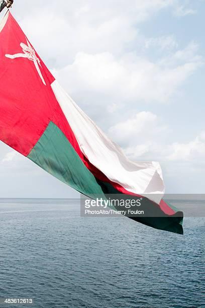 Omani flag rippling in breeze