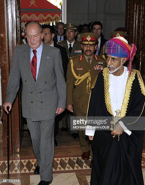 Omani leader Sultan Qaboos bin Said walks alongside Spanish King Juan Carlos during a welcome ceremony in Muscat on April 29 2014 AFP PHOTO/MOHAMED...