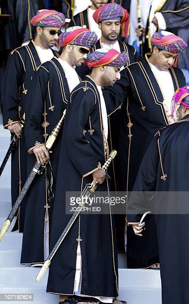 Omani members of the ruling family attend a military parade at a stadium in Muscat on the occasion of the Sultanate's 40th anniversary on November 29...